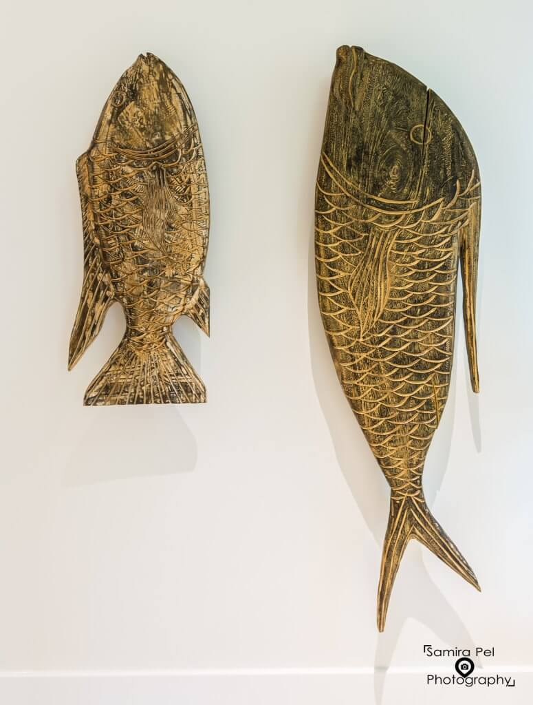 Ivy Boutique Wellness fish carvings